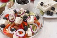 Greek salad, vegetable salad from tomato, cucumber, olives, onion, feta, sweet pepper, spices. Greek salad, vegetable salad from tomato, feta, sweet pepper stock images