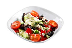 Greek salad. Vegetable with shitake mushrooms, green salad, with cherry tomatoes, fetta cheese, red onion, and mixed stock photography