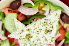 Greek salad, vegetables, olive oil, feta cheese, spices Stock Photos