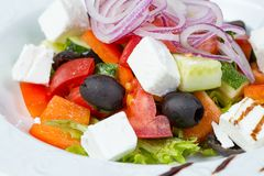 Greek salad with vegetables and red onion. On white background Stock Photography