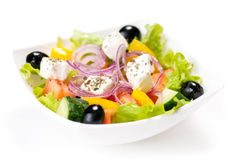 Greek salad on the white background Stock Photo
