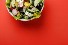 Greek salad in white bowl Royalty Free Stock Photos