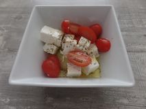 Greek salad in a white bowl royalty free stock image