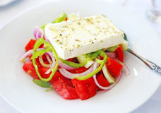 Greek salad with the white cheese feta Stock Images