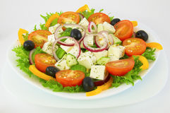 Greek salad in white plate royalty free stock images