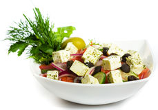 Greek Salad in white plate Stock Images