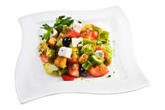 Greek salad on white plate Stock Images