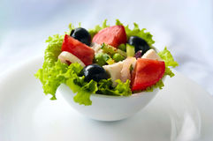 Greek salad. In the white plate Royalty Free Stock Photo