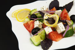 Greek salad in the white plate Stock Images