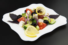Greek salad in the white plate Royalty Free Stock Photos