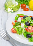 Greek salad on a white plate. Closeup Royalty Free Stock Image