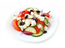 Greek Salad on white plate isolated on white Stock Image