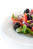 Greek salad on the white plate vertical Royalty Free Stock Images
