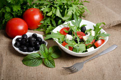 Greek salad in white salad bowl Stock Image