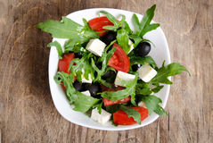 Greek salad in white salad bowl Stock Photo