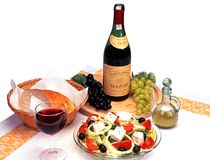Greek salad and wine. Greek Salad with Boutari wine and bread, Greece Royalty Free Stock Photos