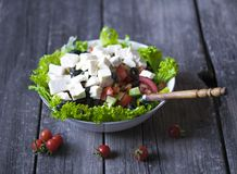 Greek salad wit tomato, cheese and olives. Tasty Greek salad wit tomato, cheese and olives stock images