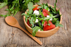 Greek salad in a wooden salad bowl Royalty Free Stock Photo