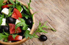 Greek salad in a wooden salad bowl Royalty Free Stock Photos