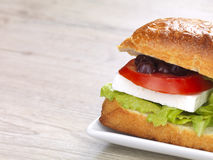 Greek sandwich. A feta, tomato,olives and lettuce sandwich in a plate stock photo