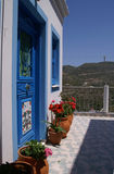 Greek scenery. Front door with flower pots in typical greek colours Stock Images