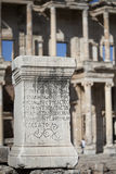 Greek script ancient letters on a rock in Ephesus Stock Photo