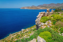 Greek sea bay with grass and bushes, Greece Stock Image