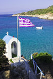 Greek sea coast. White greek chapel with blue sea in background Stock Photo