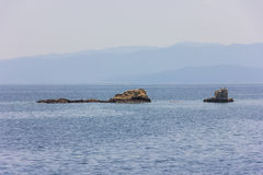 Greek sea cost with rocks Royalty Free Stock Images