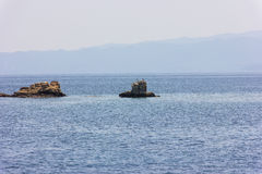 Greek sea cost with rocks Stock Images