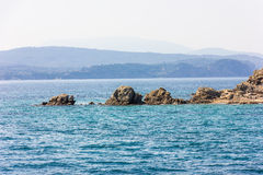 Greek sea cost with rocks Royalty Free Stock Photos
