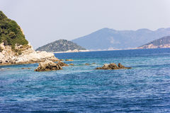 Greek sea cost with rocks Stock Photography