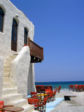 Greek seaside cafe against beautiful blue sea. Holiday and summer resort concept Stock Photography