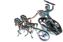 Greek Sicily 01. Miniature copper sculpture of a with four-spoke wheel chariot drawn by two horses with charioteer in fighting position Stock Photography