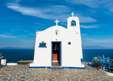 Greek small chapel. Typical greek place with a white small orthodox chapel dedicated to St. Nikolaos.Rafina,Greece Stock Images
