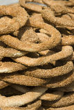 Greek snack - Koulouri. Koulouri is a circular Greek bread with sesame seeds. Are often sold by street vendors Stock Photos