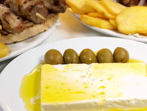 Greek Souvlaki. With gyros white cheese, olives and potatoes royalty free stock image