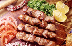 Greek Souvlaki skewers and salad royalty free stock photo