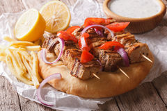 Greek souvlaki kebab with pita and vegetables close-up horizonta Royalty Free Stock Photos