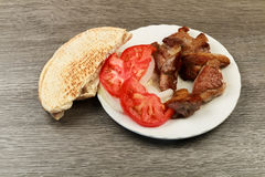 Greek souvlaki with pita bread and vegetables close-up on the table. Pork table Stock Photos