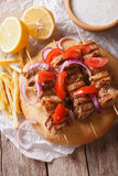Greek souvlaki with pita close-up. vertical view from above Royalty Free Stock Images
