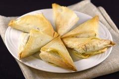 Greek spanakopita. A batch of greek baked spanakopita Royalty Free Stock Photos