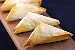 Greek spanakopita. A batch of greek baked spanakopita Stock Photography