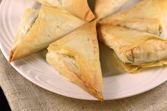 Greek spanakopita. A batch of greek baked spanakopita Stock Photos