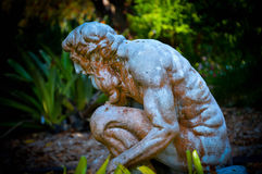 Greek statue in garden at dusk Royalty Free Stock Image