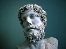 Greek Statue. A portrait shot of an ancient Greek statue against green background, shot at a museum in Copenhagen, Denmark Royalty Free Stock Images