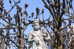 Greek statues in Mirabell gardens in Salzburg. Under plane trees Royalty Free Stock Photos