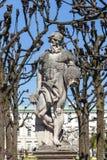 Greek statues in Mirabell gardens in Salzburg. Under plane trees Stock Image