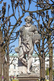 Greek statues in Mirabell gardens in Salzburg. Under plane trees Royalty Free Stock Photography