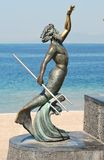 Greek statute on the Malecón in Puerto Vallarta. A greek statute stands on the Malecón in Puerto Vallarta, Mexico, in front of the Pacific Ocean Stock Images